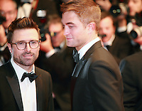 Guy Pearce and Robert Pattinson at the The Rover gala screening red carpet at the 67th Cannes Film Festival France. Sunday 18th May 2014 in Cannes Film Festival, France.