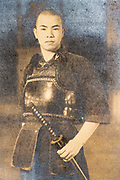 young man wearing  a kendo sports outfit with samurai sword Japan ca 1960s