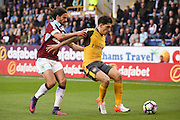 Burnley midfielder George Boyd (21) is held off by Arsenal defender Hector Bellerin (24)  during the Premier League match between Burnley and Arsenal at Turf Moor, Burnley, England on 2 October 2016. Photo by Simon Davies.