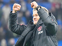 Football - 2018 / 2019 Premier League - Cardiff City vs. Manchester United<br /> <br /> Manchester Utd caretaker manager Ole Gunnar Solskjaer celebrates victory in front of his fans in his 1st game in charge, at Cardiff City Stadium.<br /> <br /> COLORSPORT/WINSTON BYNORTH