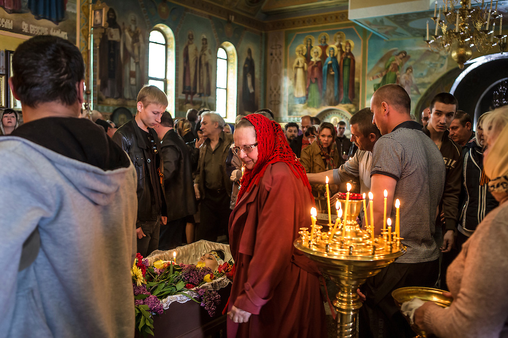 KRAMATORSK, UKRAINE - MAY 5: People gather for the funeral of Yulia Izotova, a 21-year-old nurse who was killed in fighting between pro-Russian protesters and the Ukrainian military, on May 5, 2014 in Kramatorsk, Ukraine. Cities across Eastern Ukraine have been overtaken by pro-Russian protesters in recent weeks, leading the Ukrainian military to respond with force in some areas. (Photo by Brendan Hoffman for The Washington Post)