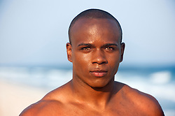 Portrait of young African American   male with no shirt at the beach