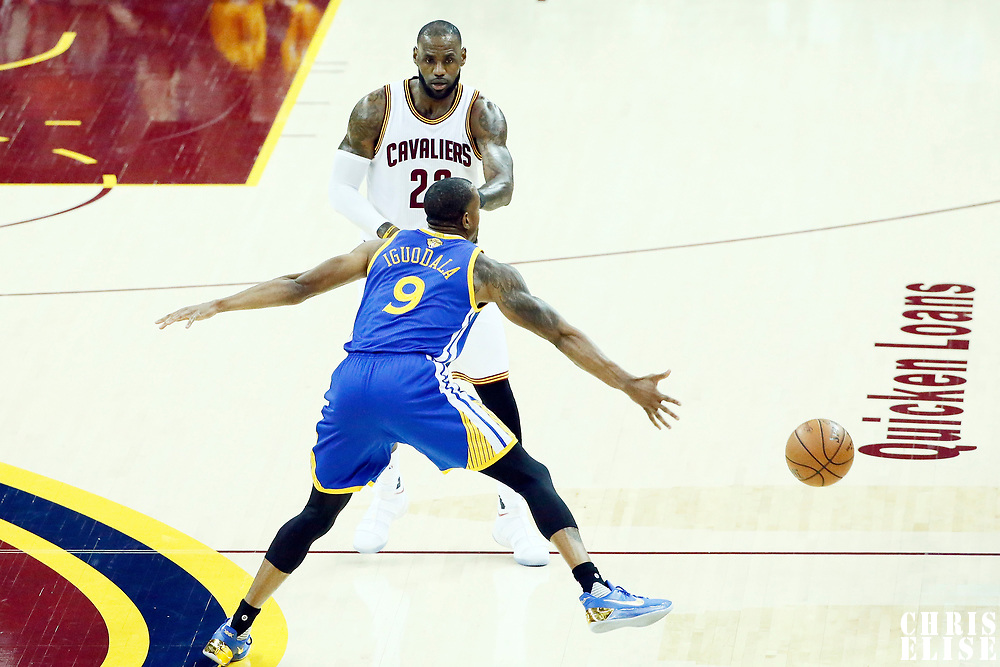 07 June 2017: Cleveland Cavaliers forward LeBron James (23) passes the ball past Golden State Warriors forward Andre Iguodala (9) during the Golden State Warriors 118-113 victory over the Cleveland Cavaliers, in game 3 of the 2017 NBA Finals, at  the Quicken Loans Arena, Cleveland, Ohio, USA.