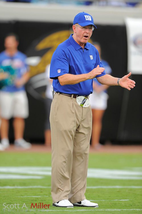 New York Giants head coach Tom Coughlin claps as his team goes through warm ups prior to their NFL preseason game against the Jacksonville Jaguars at EverBank Field on August 10, 2012 in Jacksonville, Florida. ..©2012 Scott A. Miller..