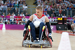 © London News Pictures. 05/09/2012. The opening game of the wheelchair rugby competition started today between ParalympicsGB and world champions USA at the Paralympic Games in Stratford, London, UK. Team USA won the match 56 - 44. Photo credit should read Manu Palomeque/LNP