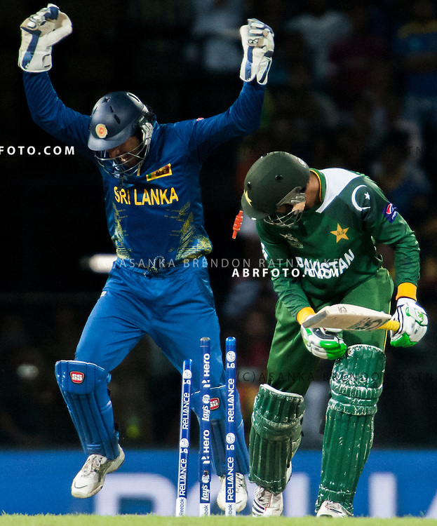 Pakistani batsmen Shoaib Malik is bowled as Sri Lankan wicketkeeper Kumar Sangakkara celebrates  during the World T20 Cricket Mens Semi Final match between Sri Lanka Vs Pakistan at the R Premadasa International Cricket Stadium, Colombo. Photo credit : Asanka Brendon Ratnayake