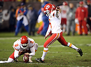 Kansas City Chiefs punter Dustin Colquitt (2) holds while Kansas City Chiefs kicker Cairo Santos (5) kicks an extra point that ties the score at 17-17 during the NFL week 12 regular season football game against the Oakland Raiders on Thursday, Nov. 20, 2014 in Oakland, Calif. The Raiders won their first game of the season 24-20. ©Paul Anthony Spinelli