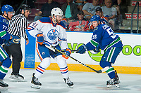 PENTICTON, CANADA - SEPTEMBER 11: Michael Carone #58 of Vancouver Canucks stick checks Evan Polei #41 of Edmonton Oilers on September 11, 2017 at the South Okanagan Event Centre in Penticton, British Columbia, Canada.  (Photo by Marissa Baecker/Shoot the Breeze)  *** Local Caption ***