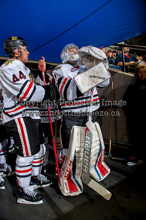 KELOWNA, CANADA - OCTOBER 21: Keoni Texeira #44 and Shane Farkas #1 of the Portland Winterhawks stand in the tunnel against the Kelowna Rockets on October 21, 2017 at Prospera Place in Kelowna, British Columbia, Canada.  (Photo by Marissa Baecker/Shoot the Breeze)  *** Local Caption ***