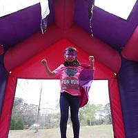 Natalie Getz, 5, practices her superhero moves Saturday morning at the CASA Superhero Run in Oxford
