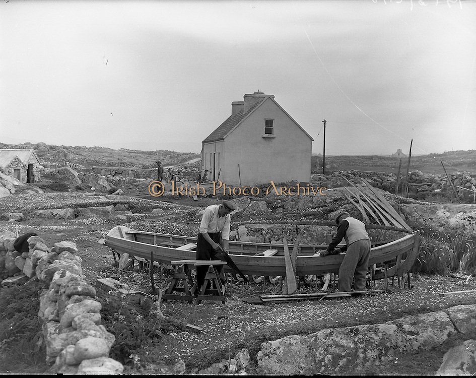 Carna.  Boat Bulding with the Cloherty family..14/05/1959<br /> The Cloherty family, 86 year old Peter and his two sons Marcin and Joseph ply their craft.