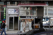 Istanbul street scene from within a bus with wedding clothing shop