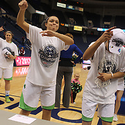 Skylar Diggins, Notre Dame, (right) dances with team mate Kayla McBride after the Connecticut V Notre Dame Final match won by Notre Dame 61-59 during the Big East Conference, 2013 Women's Basketball Championships at the XL Center, Hartford, Connecticut, USA. 11th March. Photo Tim Clayton