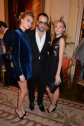 Left to right, CARA DELEVINGNE, TOM FORD and CLARA PAGET at a party hosed by the US Ambassador to the UK Matthew Barzun, his wife Brooke Barzun and editor of UK Vogue Alexandra Shulman in association with J Crew to celebrate London Fashion Week held at Winfield House, Regent's Park, London on 16th September 2014.
