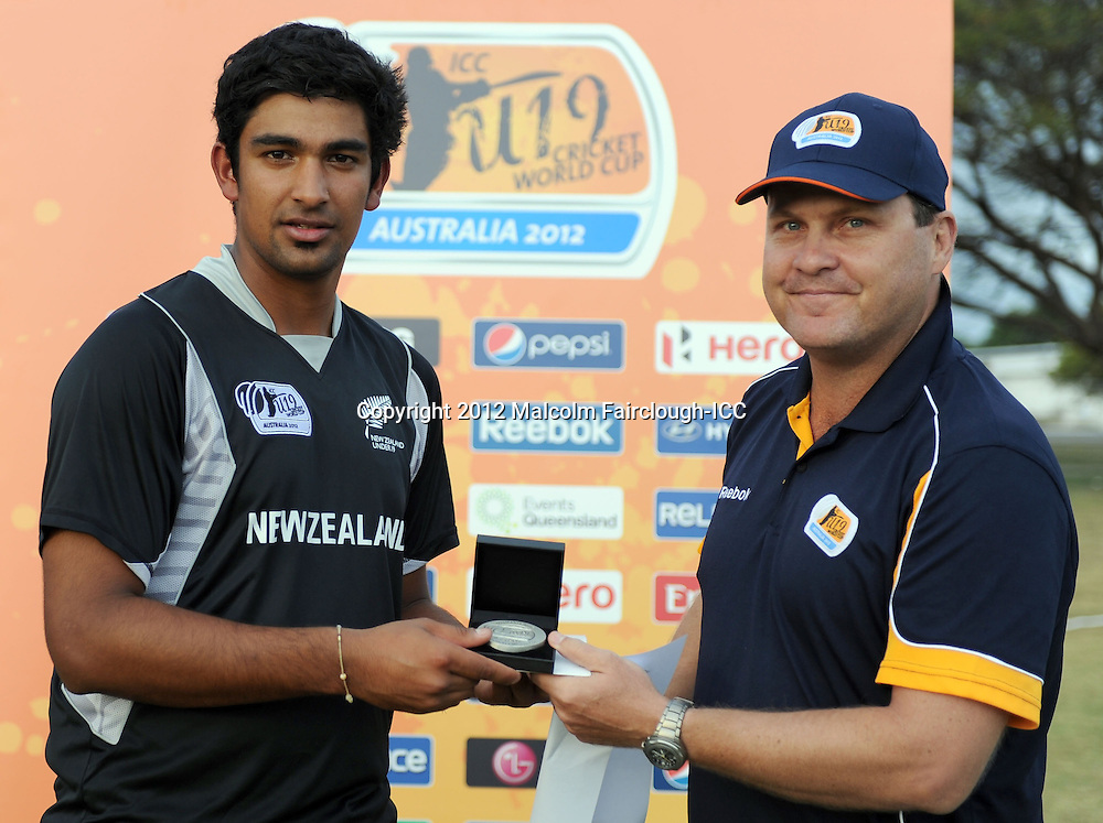 TOWNSVILLE, AUSTRALIA - AUGUST 20:  Ish Sodhi of New Zealand receives the Man of the Match award during the ICC U19 Cricket World Cup 2012 Quarter Final match between New Zealand and the West Indies at Endeavour Park on August 20, 2012 in Townsville, Australia.  (Photo by Malcolm Fairclough-ICC/Getty Images)