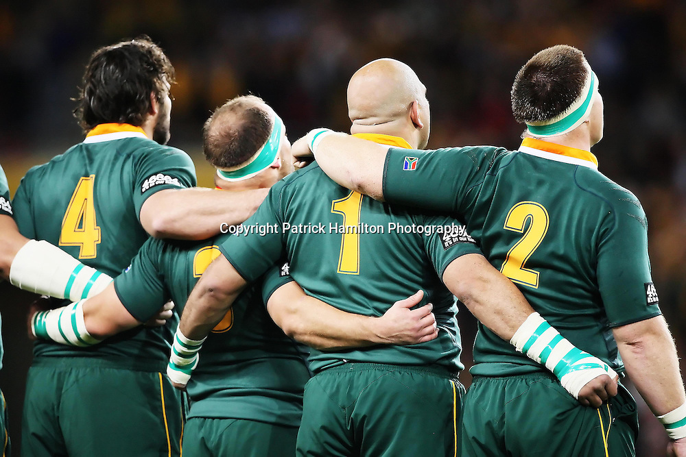 South African players l-r Danie Rossouw,BJ Botha,Gurthro Steenkamp & John Smit embrace during there national anthem before the Tri-Nations rugby Test at Suncorp Stadium in Brisbane,  July 24, 2010. The Wallabies defeated the world champion Springboks to win the first Tri-nations rugby Test 30-13. Photo: Patrick Hamilton/Photosport