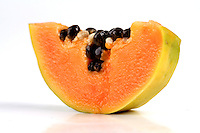 Halved papaya on white background