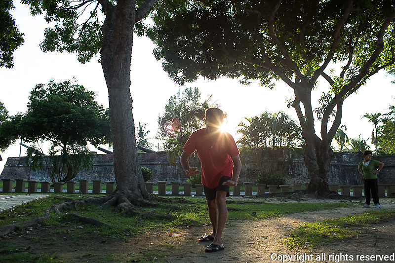 tai chi on the Esplanade near Fort Cornwallis