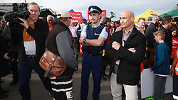 New Zealand Police stepped in when a protester wanted to have a few words to Labour Leader Jacinda Ardern as she campained at the Avondale Market, Auckland, New Zealand, Sunday, September 03, 2017. Credit:SNPA / Hayden Woodward**NO ARCHIVING**