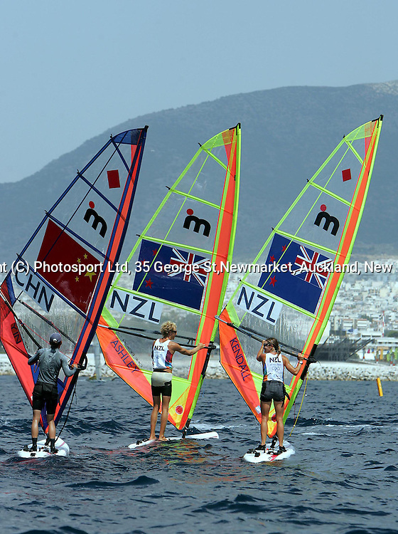 New Zealand mistral sailors Thomas Ashley and Barbara Kendall wait for breeze on the Saronic Gulf, Athens, Greece, Wednesday 11 August 2004<br />
