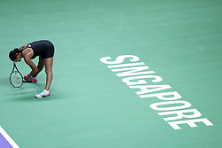 October 24, 2018 - Singapore - Naomi Osaka of Japan reacts to loosing a point during the match between Angelique Kerber and Naomi Osaka on day 4 of the WTA Finals at the Singapore Indoor Stadium. (Credit Image: © Paul Miller/ZUMA Wire)
