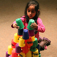 Saanvi Parida, 5, builds a castle out of cups in the Zoom Room at Healthworks Saturday during Healthwork's 9th Birthday celebration