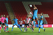 Jacob Greaves  wins a header   during the EFL Trophy match between Exeter City and Cheltenham Town at St James' Park, Exeter, England on 3 September 2019.