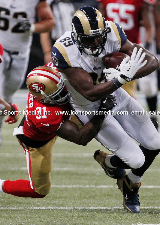 Sept. 26, 2013 - St Louis, MO, USA - St. Louis Rams tight end Jared Cook tries to break away from the San Francisco 49ers' Donte Whitner on Thursday, September 26, 2013, at the Edward Jones Dome in St. Louis, Missouri. The 49ers won, 35-11