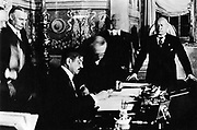 Benito Mussolini and French Prime Minister Pierre Laval sign French-Italian agreement in Rome. 1935