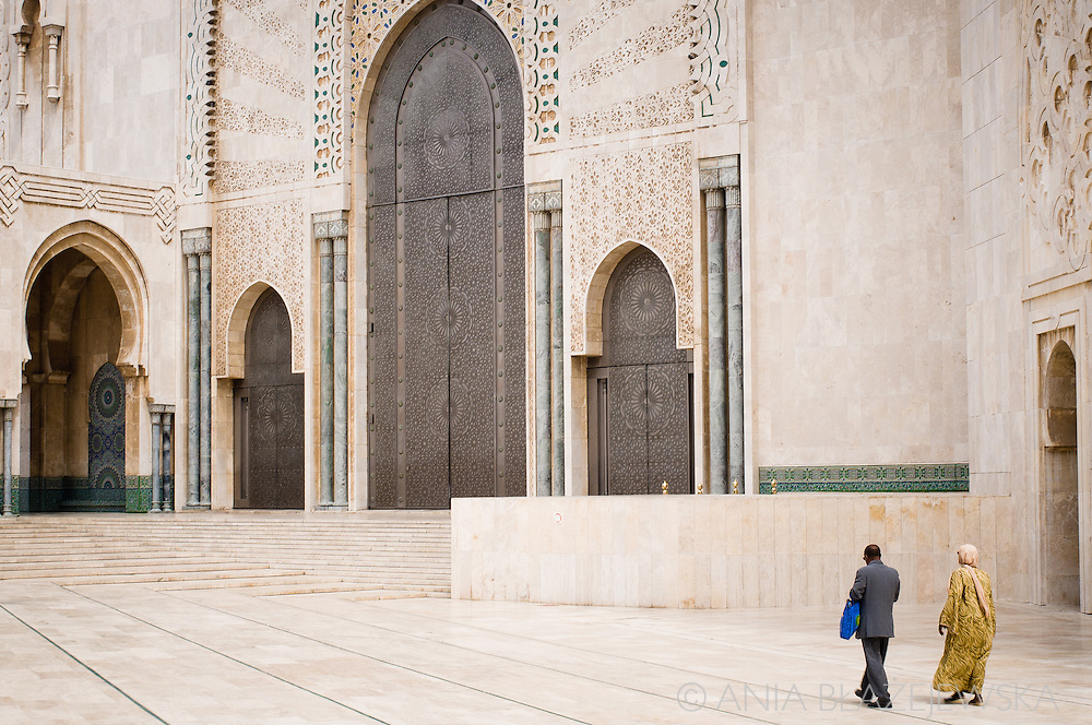 Morocco, Casablanca. Muslim couple at the Hassan II Mosque courtyard.