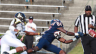 Samford wide receiver Gavin Sinclair  reaches for the ball as Appalachian State defensive back Demtrious McCray grabs him and the results was pass interference and gave them another chance at Seibert Stadium in Homewood, Ala., Saturday, Oct 13, 2012. (Marvin Gentry)