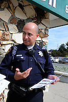 At the Hebbron Center, officer Richard Lopez explains how the team makes connections between probation records, school truancy and shared information from parents.