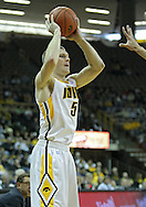 December 04 2010: Iowa Hawkeyes guard Matt Gatens (5) looks for a player to pass to during the first half of their NCAA basketball game at Carver-Hawkeye Arena in Iowa City, Iowa on December 4, 2010. Iowa won 70-53.