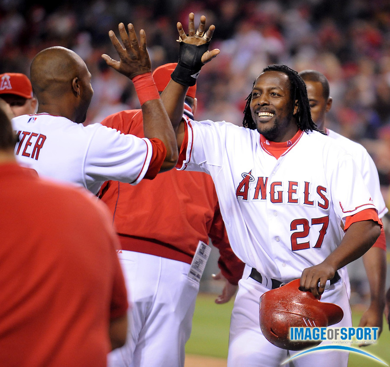 May 26, 2008; Anaheim, CA, USA; Los Angeles Angels right fielder Vladimir Guerrero (27), right, celebrates with center fielder Torii Hunter (48) after 1-0 victory over the Detroit Tigers in 12 innings at Angel Stadium. Mandatory Credit: Kirby Lee/Image of Sport-US PRESSWIRE