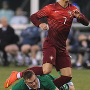 Cristiano Ronaldo, Portugal, shoots past Alex Pearce, Ireland, during the Portugal V Ireland International Friendly match in preparation for the 2014 FIFA World Cup in Brazil. MetLife Stadium, Rutherford, New Jersey, USA. 10th June 2014. Photo Tim Clayton
