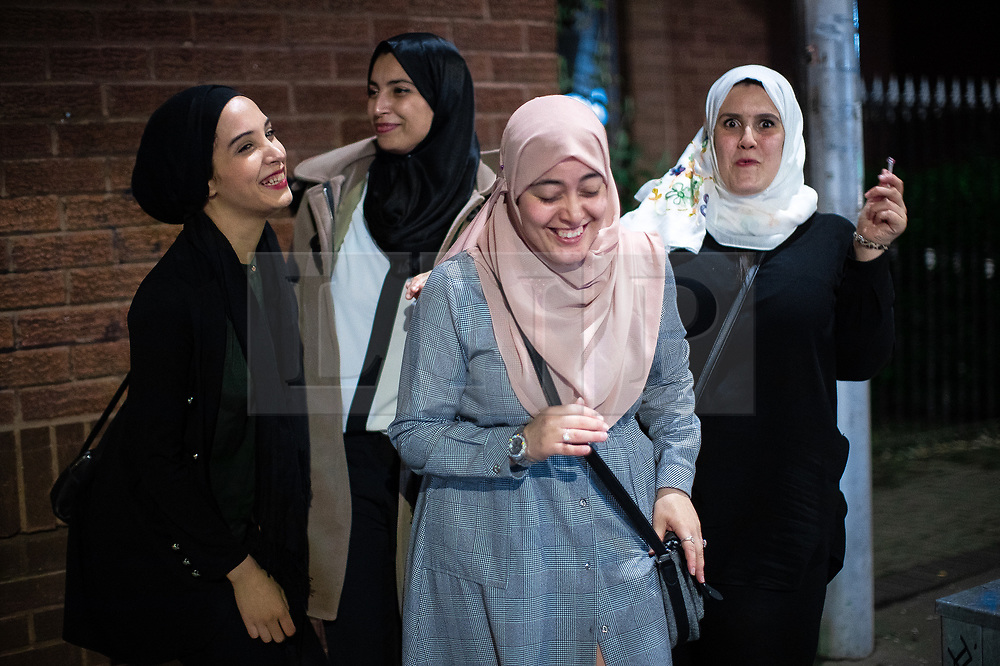 """© Licensed to London News Pictures. 05/06/2019. Manchester, UK. HADJER TAIBI (25 from Withington) , NAIMA BENYAHLOU (25 from Crumpsall), HALIMA BENZDIRA (27 from Withington) and DOUNIA (26 from Fallowfield) - who call themselves """" The Algerian Squad """" . People celebrate Eid-ul-Fitr , the end of a month of fasting during Ramadan , in Rusholme in Manchester . Photo credit: Joel Goodman/LNP"""