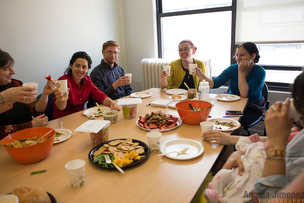 Students hold a lunch honoring Ruth Balinsky Friedman (Class of 2013), second from right, and Rori Picker Neiss (Class of 2014), right, both of whom are leaving the school this year for professional clergy positions. Friedman, who is graduating, has a placement with a synagogue in Washington D.C.. Neiss, who will complete her last year of study remotely, has a placement with a synagogue in St. Louis, Missouri. <br /> <br /> Also pictured from left, Miriam Gonczarska (Class of 2015, of Poland) Dr. Anat Sharbat (Class of 2015, of Israel), Friedman's husband Yoni Friedman, and Ramie Smith (Class of 2016).<br /> <br /> The female students of Yeshivat Maharat, &quot;the first institution to train Orthodox women as spiritual leaders and halakhic authorities,&quot; study at the Drisha Institute in New York City in preparation for the school's inaugural graduation on June 16, 2013. <br /> <br /> Three women will be the first to graduate from the four-year school and will be given the title &quot;Maharat&quot;, a Hebrew acronym for &quot;Manhiga Hilkhatit Rukhanit Toranit&quot; which translates to a teacher of Jewish law and spirituality.The school, which currently has 14 students, was founded by Rabbi Avi Weiss. Rabbi Wiess controversially ordained the first female Orthodox Rabba in history, Rabba Sara Hurwitz, who serves as the dean of the school. <br /> <br /> <br /> Photo by Angela Jimenez <br /> www.angelajimenezphotography.com