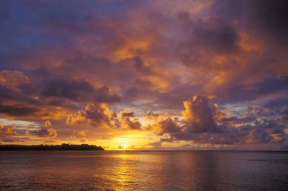 Sunset and clouds over ocean Tumon Bay, Guam, from the Fujita Tumon Bay Hotel.