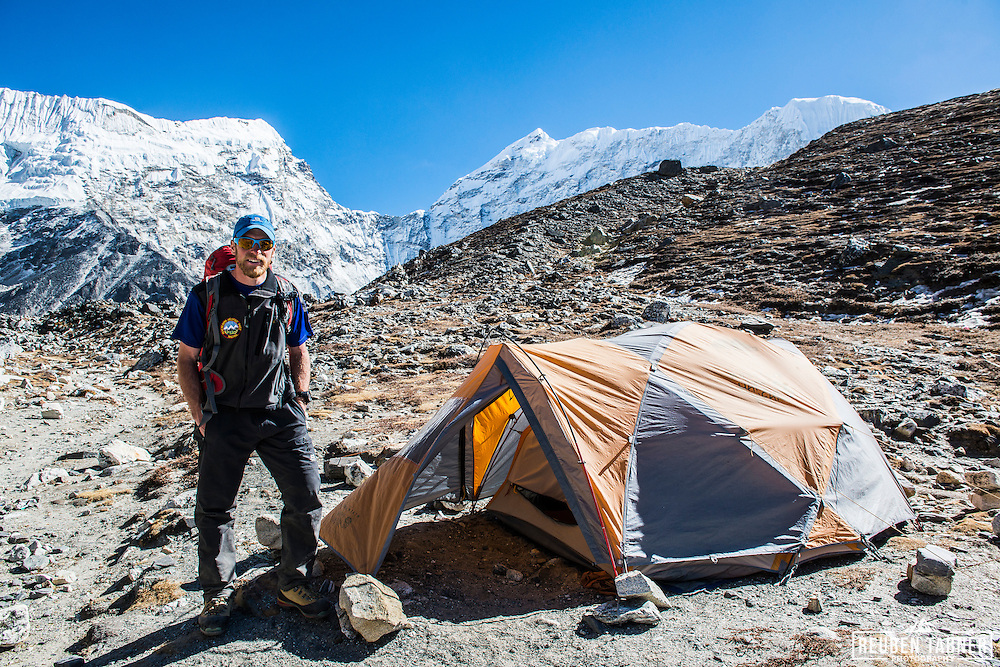 Reuben standing next to his Mountain Hardwear tent at Island Peak Base Camp, which is at 4970 metres and on the side of the Lhotse Shar Glacier and Imja Tsho (lake).