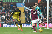 Aston Villa midfielder Birkir Bjarnason (20) clears the ball from Burton Albion striker Lucas Akins (10) during the EFL Sky Bet Championship match between Aston Villa and Burton Albion at Villa Park, Birmingham, England on 3 February 2018. Picture by Richard Holmes.