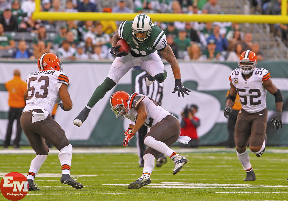 Dec 22, 2013; East Rutherford, NJ, USA; New York Jets tight end Kellen Winslow (81) leaps over Cleveland Browns cornerback Buster Skrine (22) during the first half at MetLife Stadium.