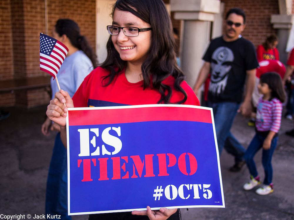 05 OCTOBER 2013 - PHOENIX, ARIZONA:   A girl at an immigration march in Phoenix Saturday. More than 1,000 people marched through downtown Phoenix Saturday to demonstrate for the DREAM Act and immigration reform. It was a part of the National Day of Dignity and Respect organized by the Action Network.    PHOTO BY JACK KURTZ
