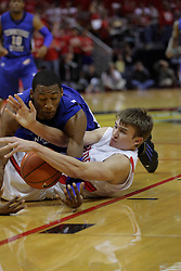 17 November 2010: Struggling for a loose ball, Jon Ekey gets landed on by Robert Covington during an NCAA basketball game between the Tennessee State Tigers and the Illinois State Redbirds at Redbird Arena in Normal Illinois.