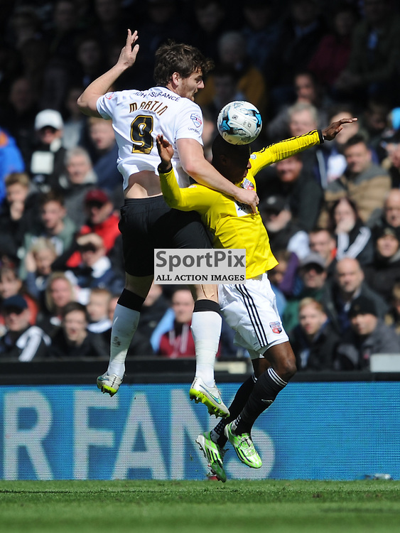 Derbys Chris Martin Climbs above Moses Odubajo, Derby County  v Brentord, Sky Bet Championship, IPro Stadium Saturday 11th April 2015