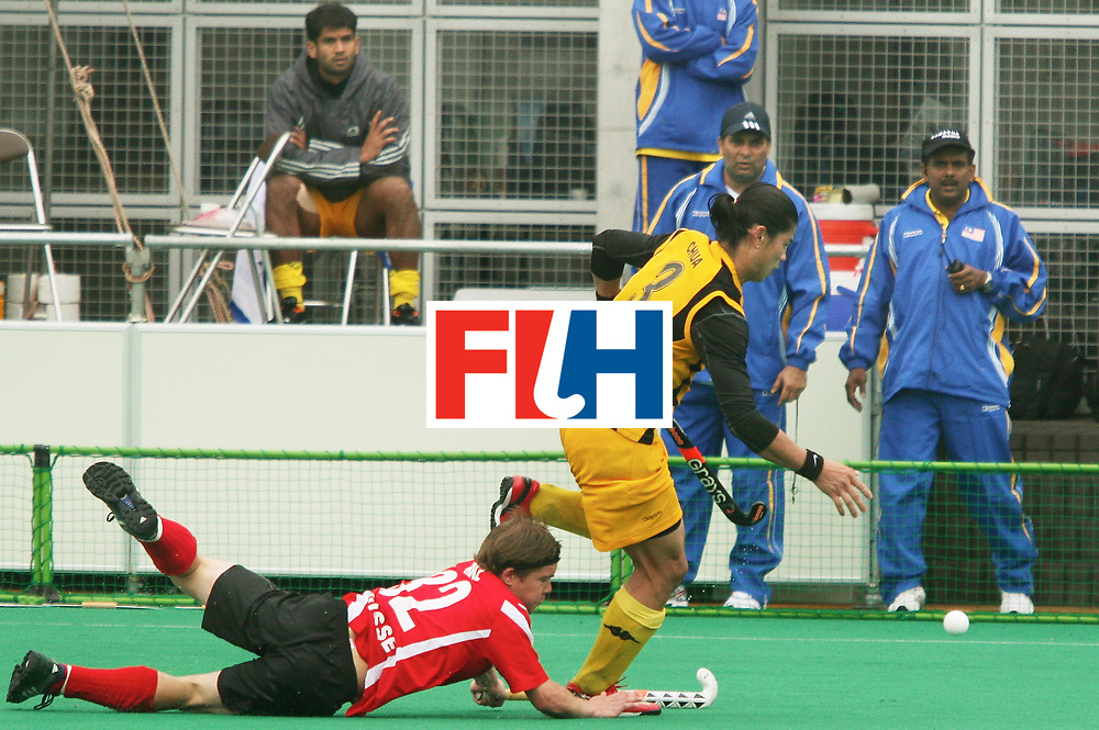 Kakamigahara (Japan): Boon Huat Chua being challenged by Andreas Benz of Switzerland in the Olympic Hockey Qualifier at Gifu Perfectural Green Stadium at Kakamigahara on 10 April 2008.  Malaysia beat Switzerland 4-3. Photo: GNN/ Vino John