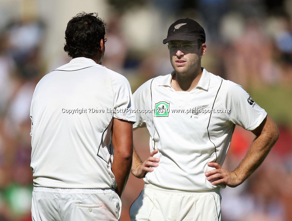 NZ captain Daniel Vettori talks to bowler Daryl Tuffey.<br /> 1st cricket test match - New Zealand Black Caps v Australia, day one at the Basin Reserve, Wellington.Friday, 19 March 2010. Photo: Dave Lintott/PHOTOSPORT