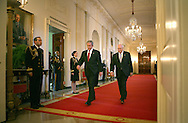 President George W. Bush and Vice President Dick Cheney walk into the East Room of the White House to sign HR.7081, the United States-India Nuclear Cooperation Approval and Nonproliferation  Enhancement Act on October 8, 2008.   Photograph: Dennis Brack