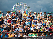 "14 AUGUST 2019 - DES MOINES, IOWA: Spectators watch ""Mutton Busting"" at the Iowa State Fair. Mutton Busting is a rodeo like event in which children ride sheep. The Iowa State Fair is one of the largest state fairs in the U.S. More than one million people usually visit the fair during its ten day run. The 2019 fair run from August 8 to 18.               PHOTO BY JACK KURTZ"