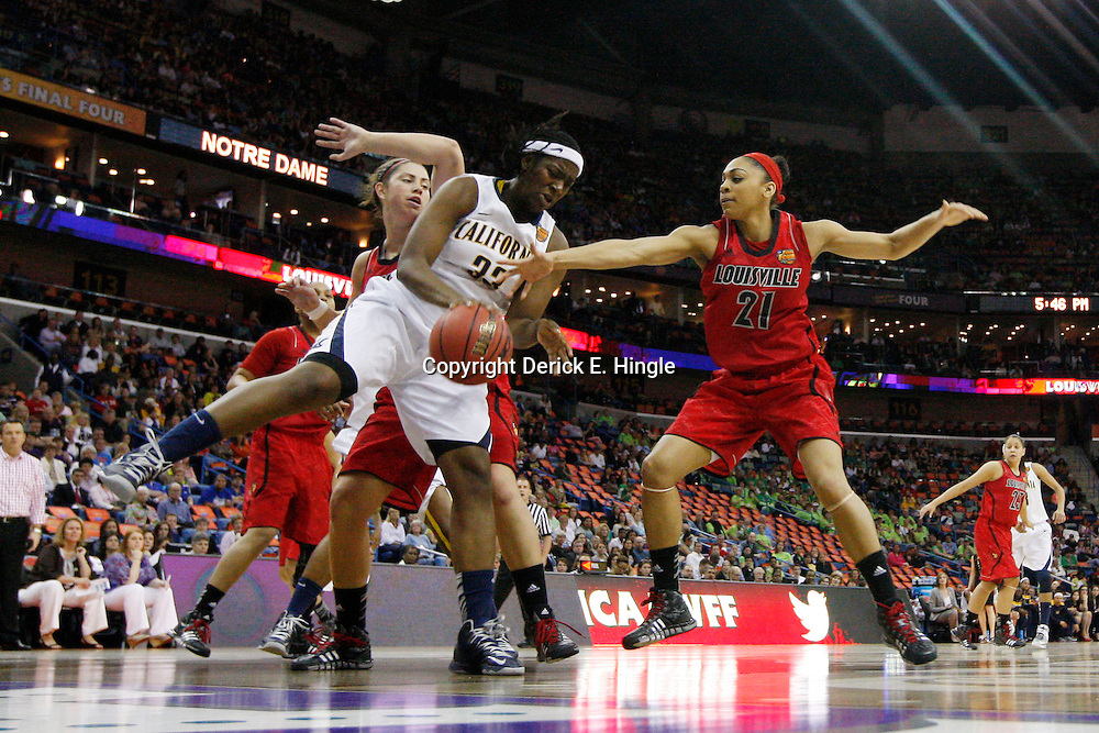 April 7, 2013; New Orleans, LA, USA; California Golden Bears center Talia Caldwell (33) is defended by Louisville Cardinals guard Bria Smith (21) during the first half in the semifinals during the 2013 NCAA womens Final Four at the New Orleans Arena. Mandatory Credit: Derick E. Hingle-USA TODAY Sports