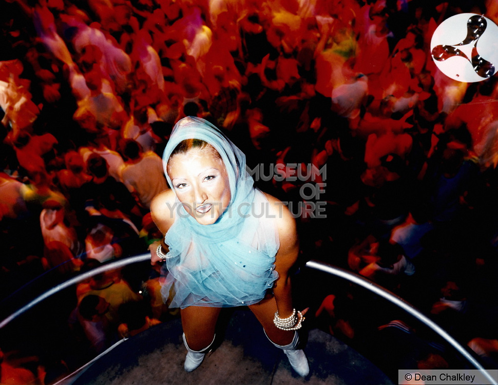 Pouting club dancer standing on her podium with clubbers below Cream, Amnesia, Ibiza 1999